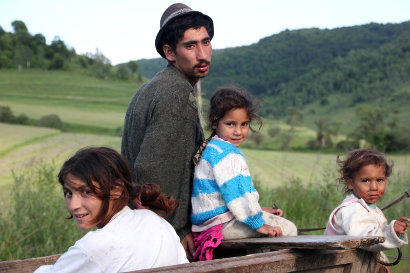 A Roma (or gypsy) family in a horse-drawn wagon.