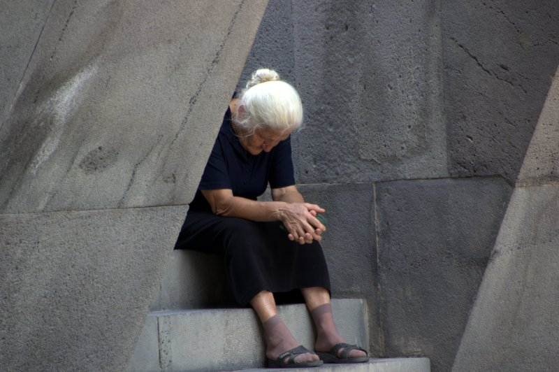 Woman reflecting at the Genocide Museum in Yerevan, Armenia's capital.