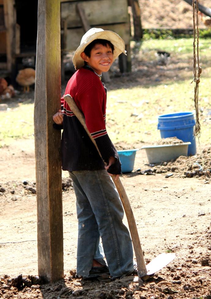 Sweet farm boy taking a break from planting & weeding.