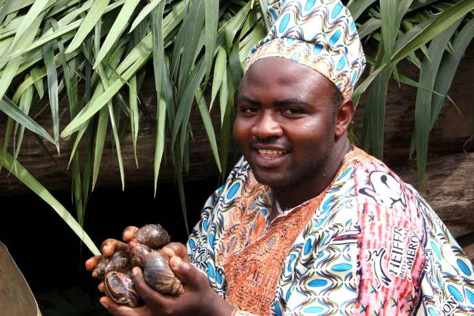 Tangue Jokelt Dieudonne, proud member of Heifer's  Melong GIC with his snails
