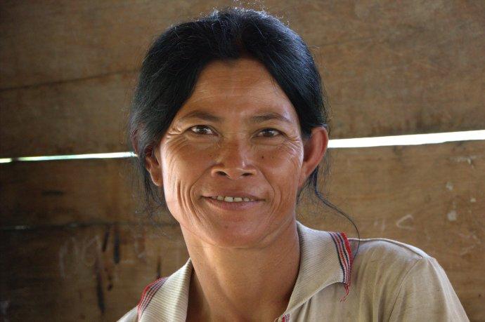Kuhl Samon, mother of 11, and wife of Chin Chhil, an amputee in the war.